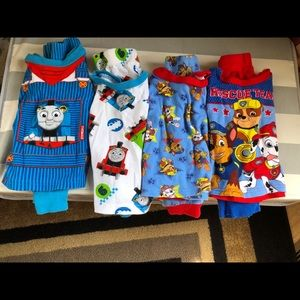 4 pairs of pjs, 2 Thomas and Friends, 2 Paw Patrol